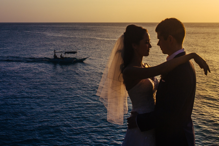 A couple poses at sunset for their Boracay wedding photographer