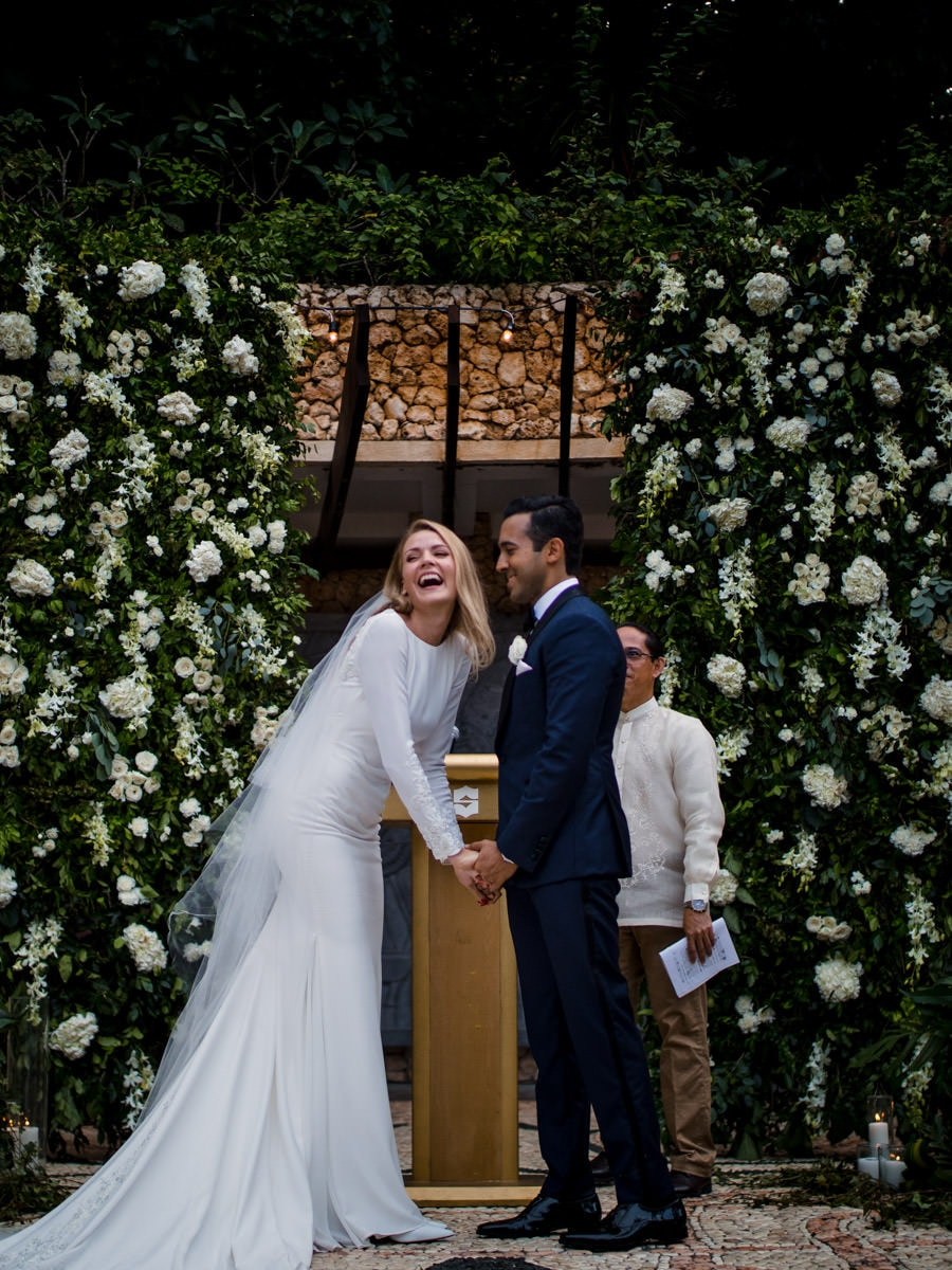 A bride and groom during their ceremony by Shangri-La wedding photographer Julian Abram Wainwright
