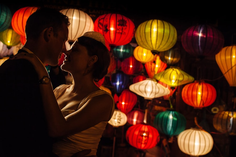 A Vietnam wedding photographer shoots a couple with lanterns in the ancient city of Hoi An, Vietnam.